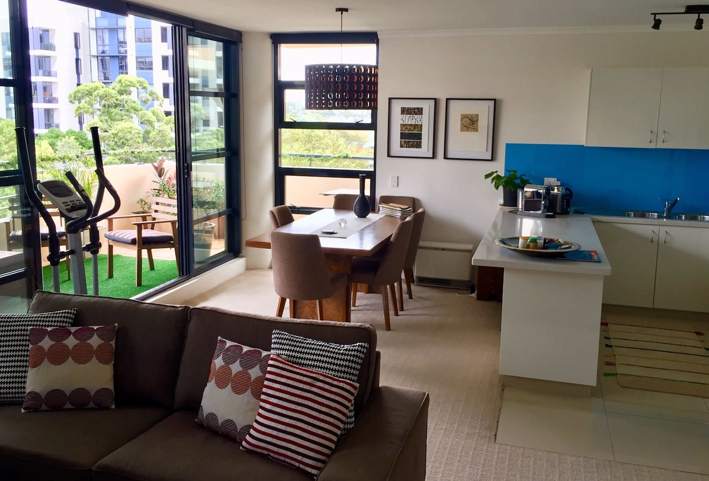 Open plan living/ kitchen/ dining opening onto large balcony