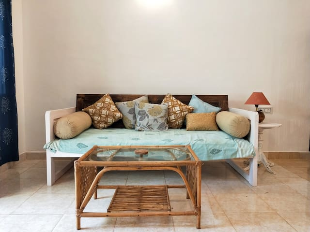 Unwind on this daybed after a day of exploring Goa.