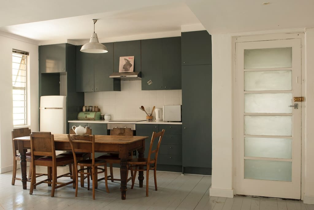 The kitchen where you can prepare a meal, brew some coffee or use the table as a workspace.