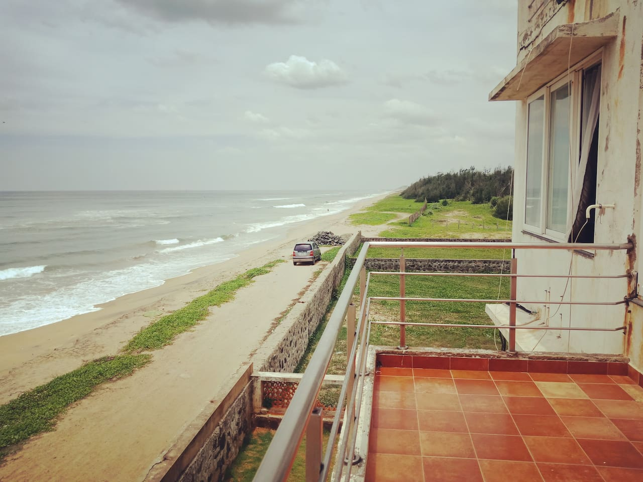 Stunning views from the first floor balcony overlooking the sea!  Get set for that special awe inspiring sunrise!