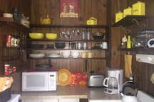 Microwave, toaster, coffee pot, stove and refrigerator