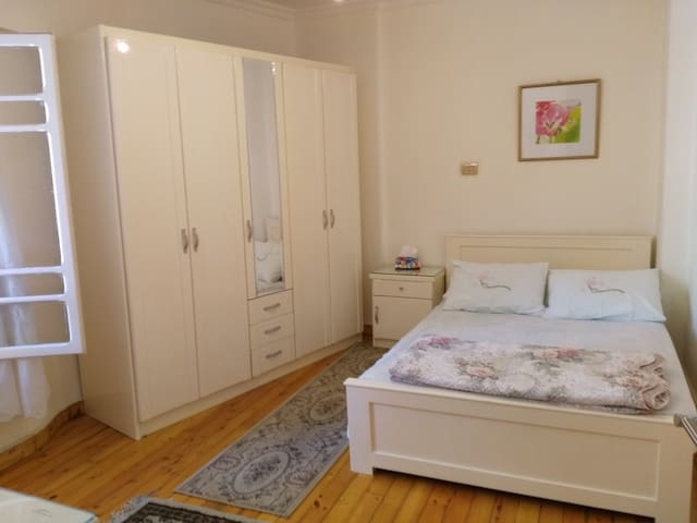Main bedroom for two persons. Double size bed, wardrobe, dresser with mirror and an air conditioner.
