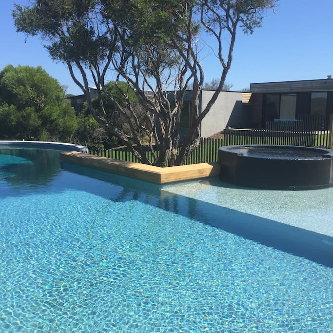 17 metre pool with spa, shallow paddling area and 3 m deep end. View toward house with rolling lawn area.