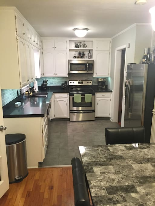 Fully stocked kitchen for any and all cooking needs. Includes: microwave, stove, dishwasher, toaster, coffee maker, plates, cups, silverware, measuring utensils and fridge (ice/water dispenser).