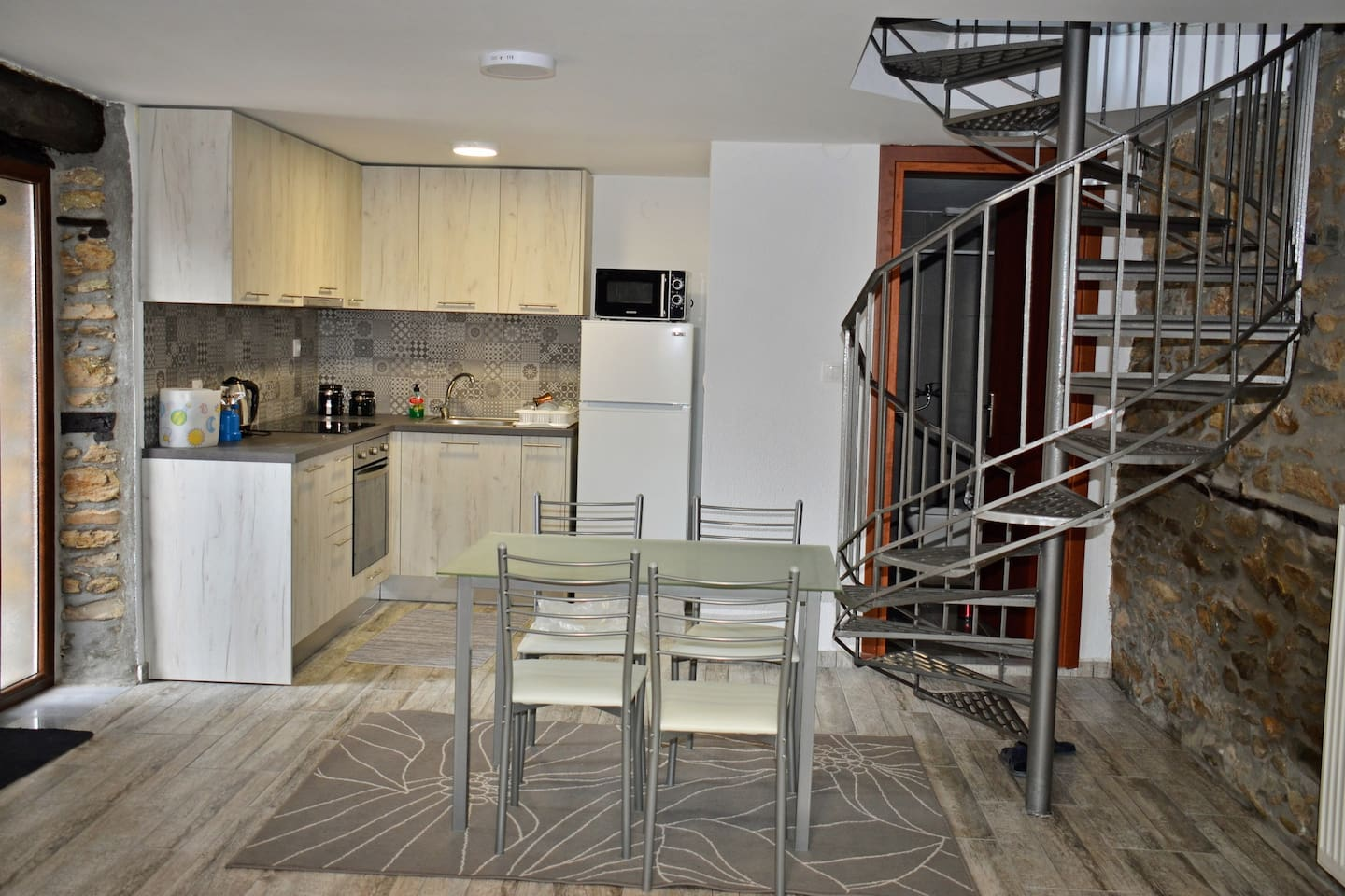 Fully equipped kitchen with pots, pans, coffee, etc and spiral stairs