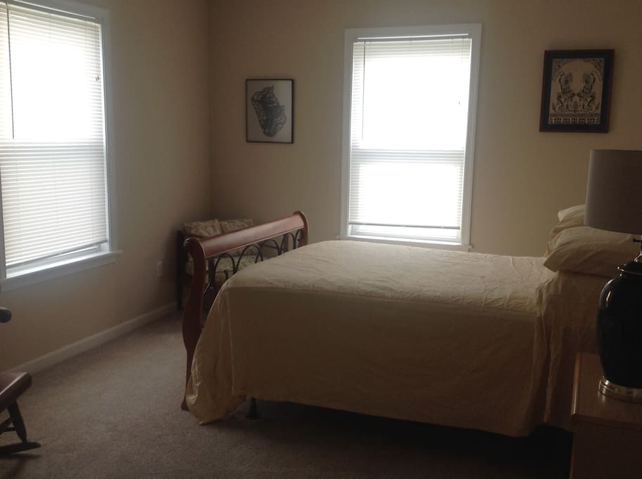 Bedroom with full bed, dresser, and closet.