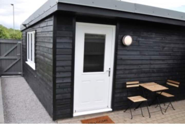 Self contained garden cabin with off road parking