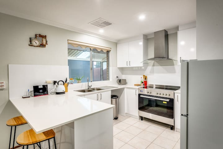 Kitchen with granite top and ceramic stove/oven