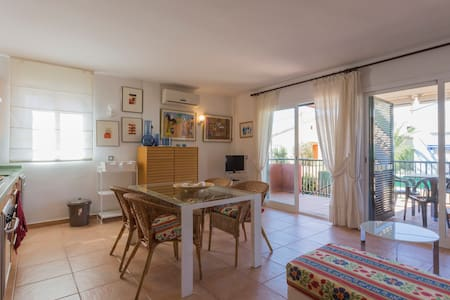 Apartment at sea with swimming pool