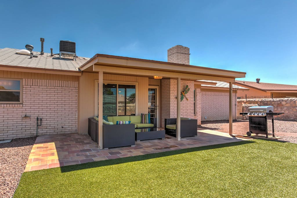 The property features a spacious fenced in backyard, with outdoor furnishings and a gas grill!