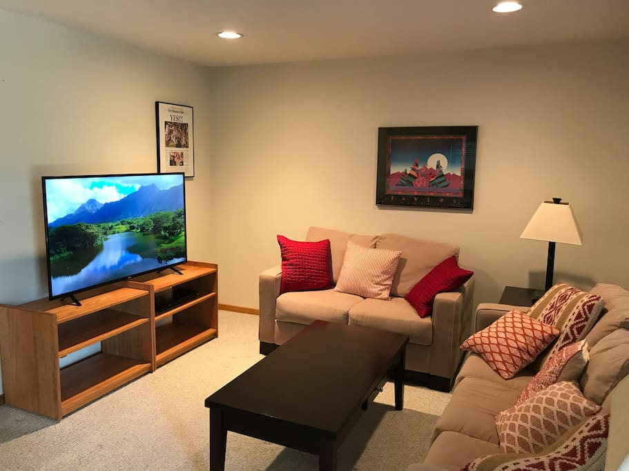 "Family room with 55"" 4K TV"