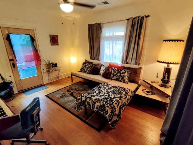 bedroom #2 and living room/lounge with a two narrow twin day bed sectional that converts into a queen. has its own private side entrance and roku tv