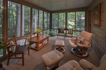 large sunroom with slider windows