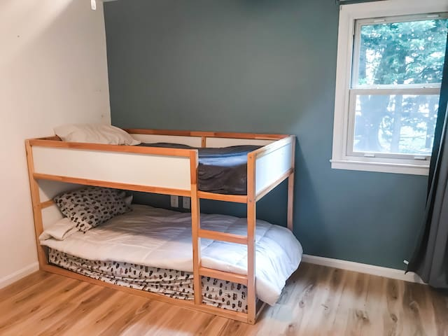 (Upstairs) bunk bedroom with dresser and closet.