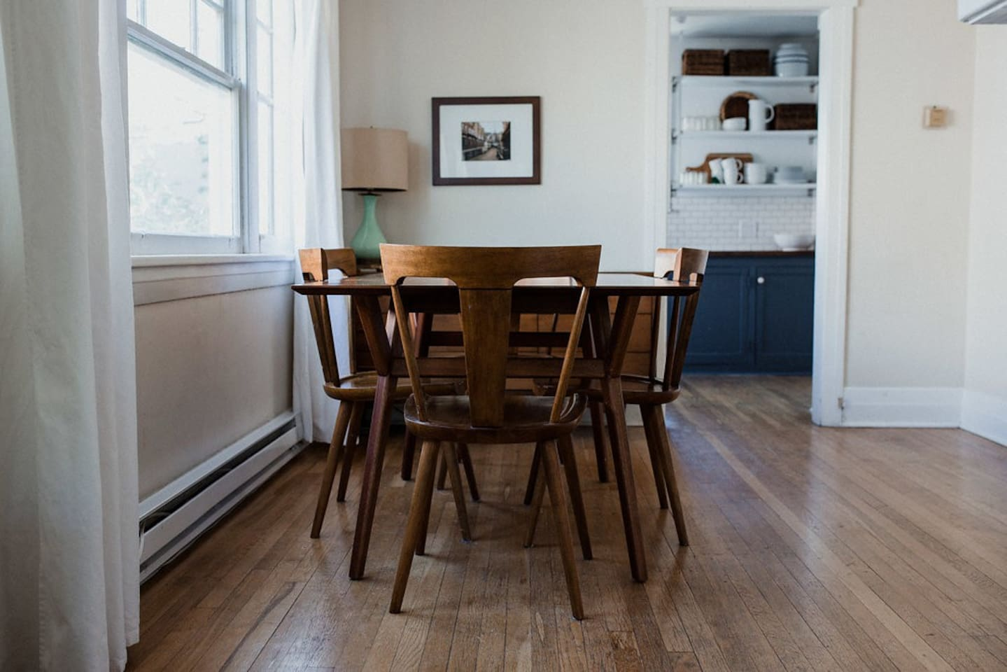 Cottage Blue's decor is a stylish blend of mid-century modern and 1920s sophistication.