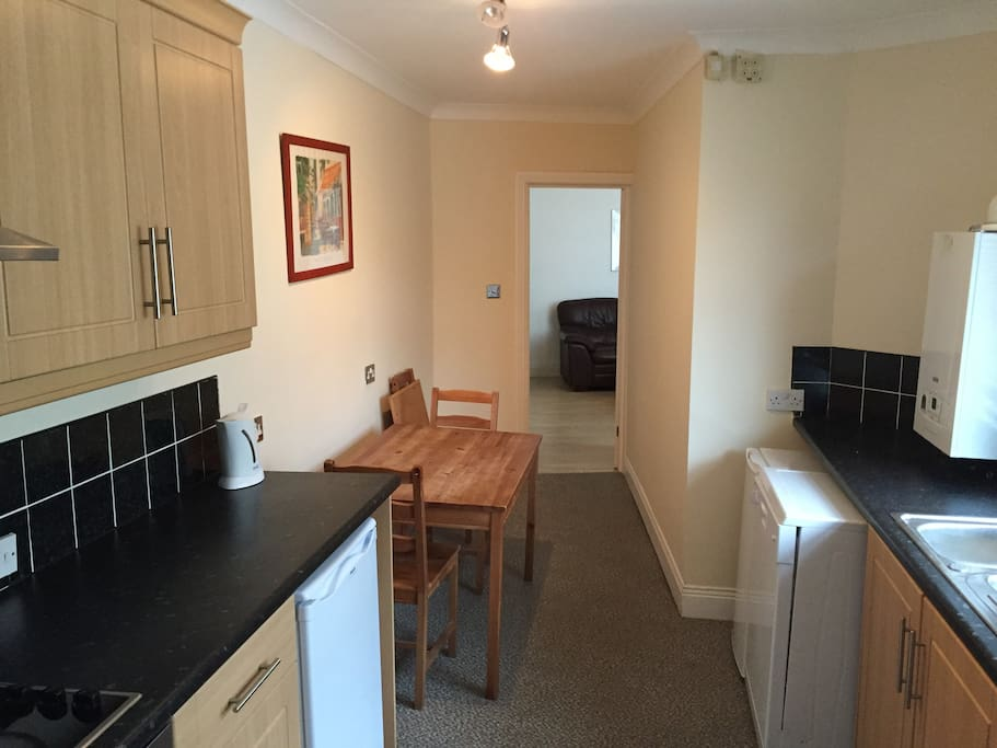 The spacious kitchen with full cooker , microwave , dishwasher , fridge and freezer