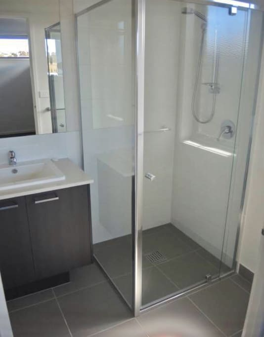 Your private ensuite is functional and compact, combining shower, sink and toilet.