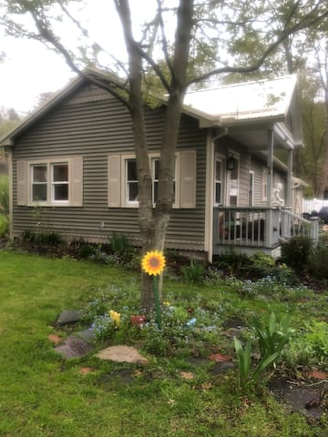 Look for the wooden sunflower against the tree to identify my house in the spring and summer.