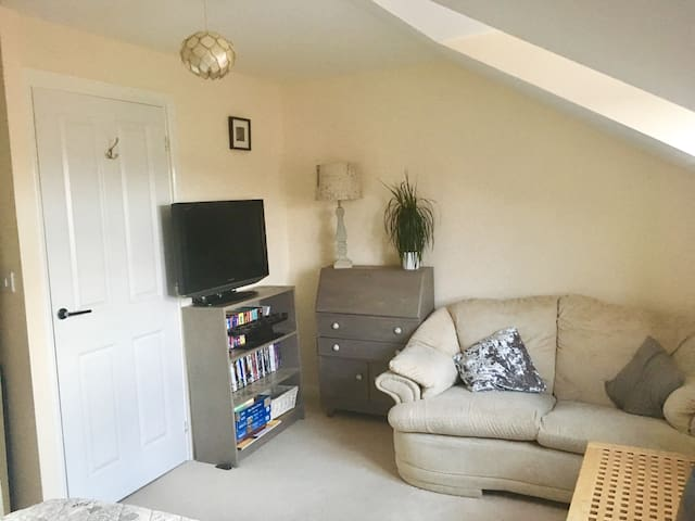 A delightful double bedroom with sofa & sky tv
