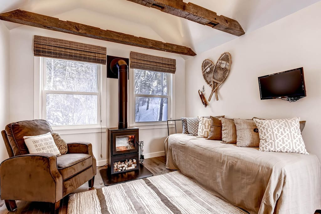 Day bed by warm fireplace for 2 in living room