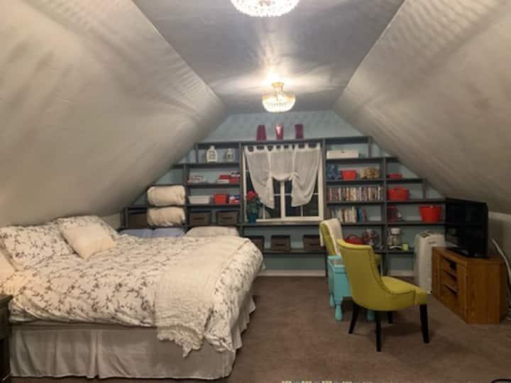 The Hollyhock Suite in Manti, Utah. King bed.