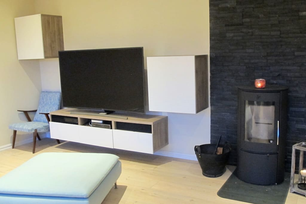A big TV and a fireplace
