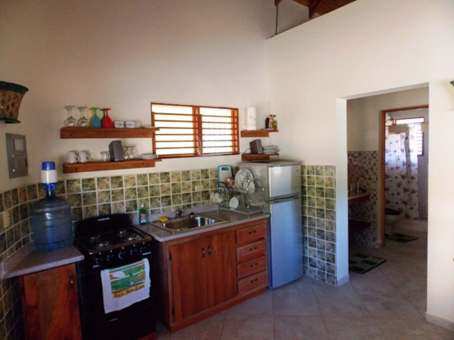 fully equipped kitchen with fridge and stove