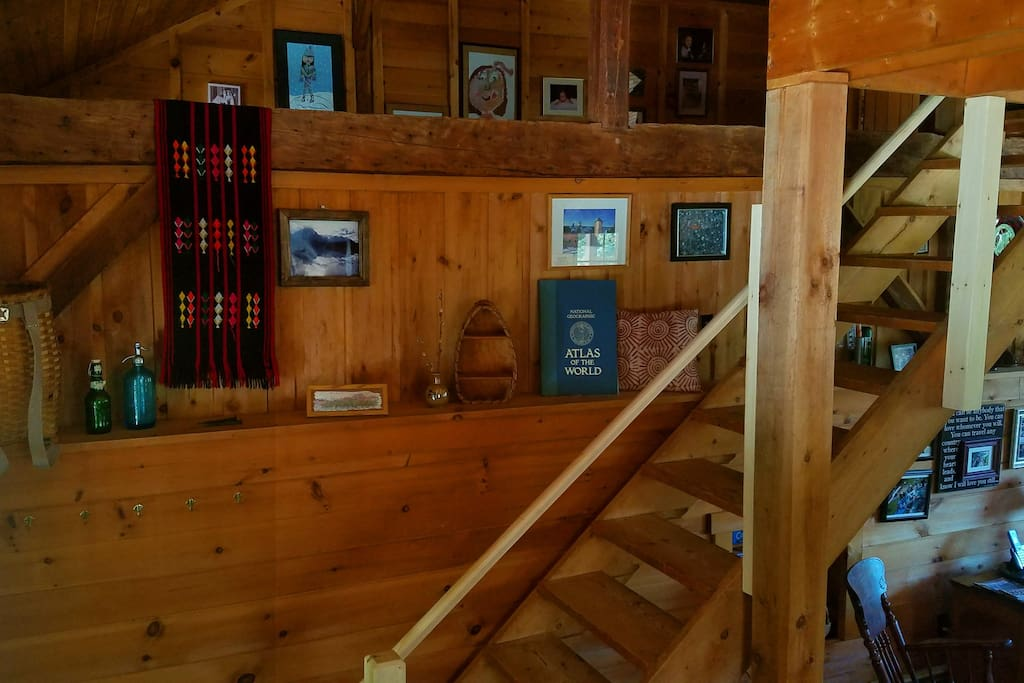 The converted barn has lots of different levels to explore. Hand-hewn  post-and-beams are exposed throughout the house.