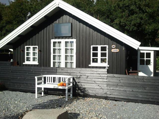 Hela - Hemmet - Houten huisje