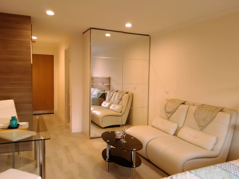 Large build in wardrobe with generous hanging space, drawers, tie rack and shoe drawers. Leather lounge, multi tier coffee table. LED lighting throughout with electronic dimmer