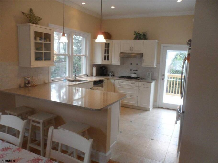 Kitchen with new appliances, and heated floor for cool mornings or evening.