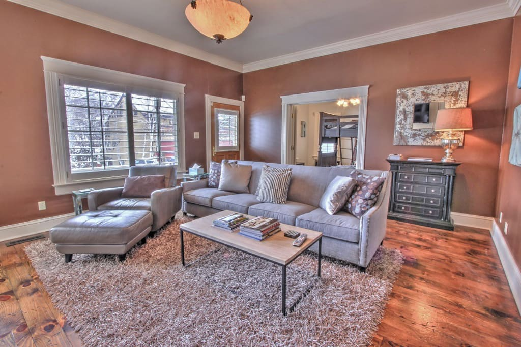 Cozy main level living room with fireplace and flat screen TV