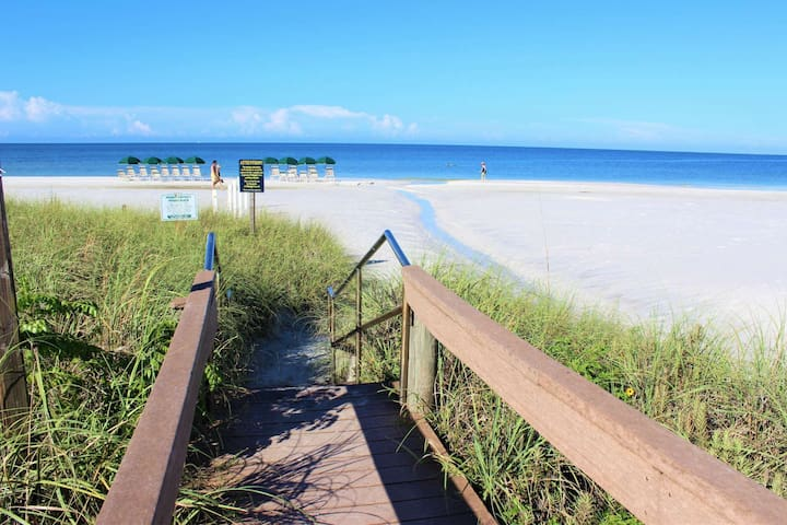 Beach Access through a private gate.  Please note that beach chairs are not provided at the beach for this complex.