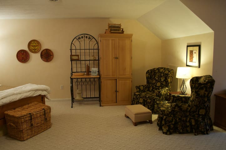 The sitting area and kitchen armoire