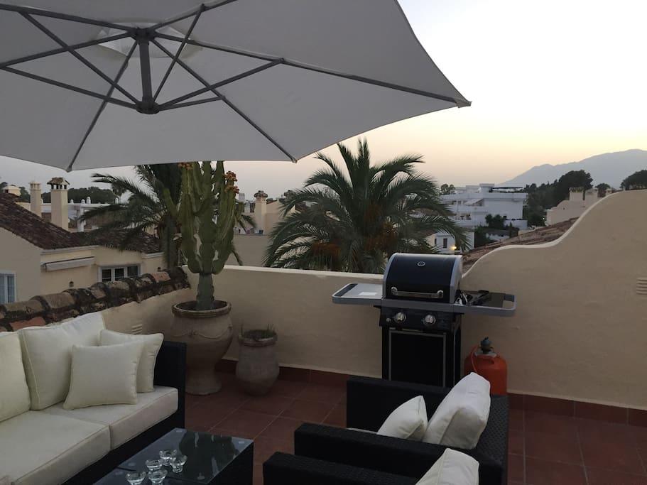 Fantastic lounge area on rooftop terrace with barbecue and sea view