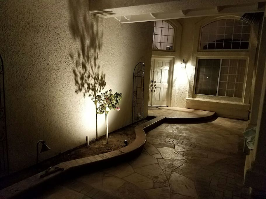 Brightly lit entryway at night.
