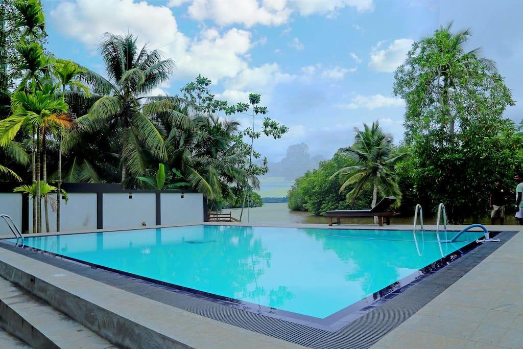 Swimming pool with sun loungers plus lagoon views!