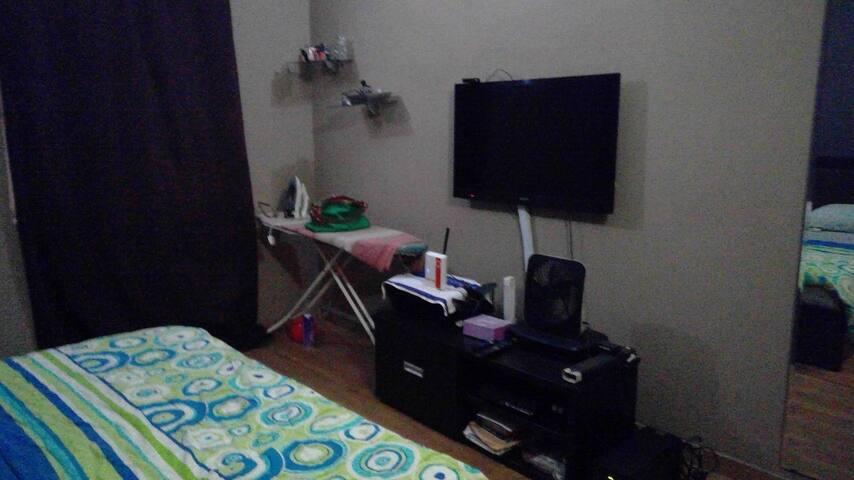 Master Bedroom  DSTV Explorer,  40inch Sony TV, Ironing board  Floor length mirror and 2 standard windows for cross ventilation
