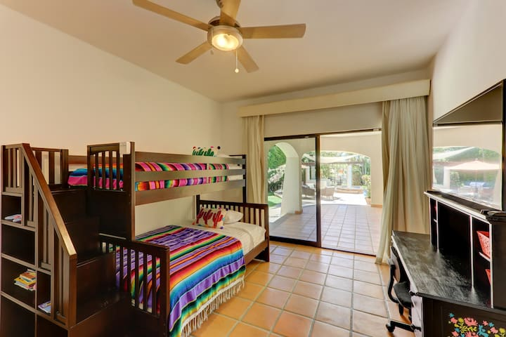 Poolside bunk bed access gives you an opportunity to walk through sliding glass doors to the outdoor patio.
