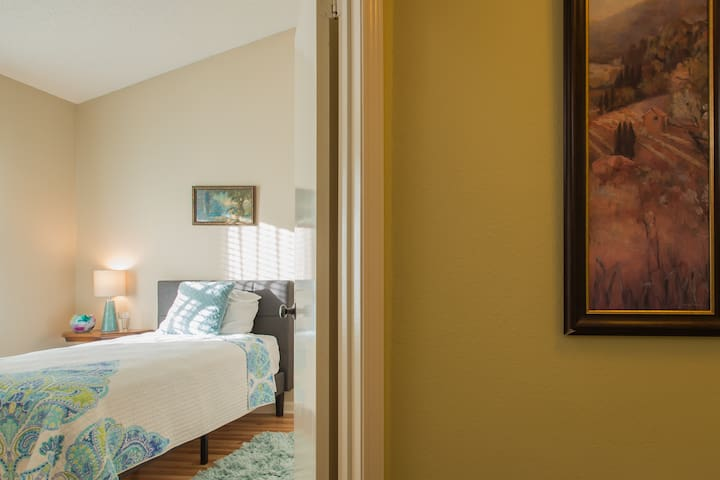 Bedroom 1 featuring comfortable twin bed.