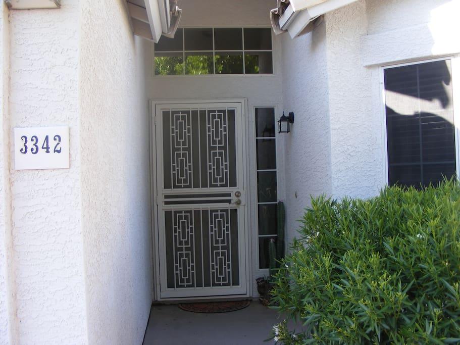Double front door including metal screen door for added security.