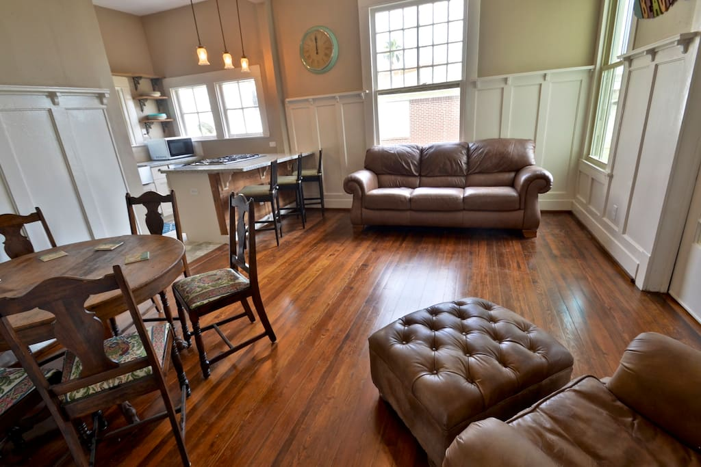 luxury living area with leather couches and seating for 10