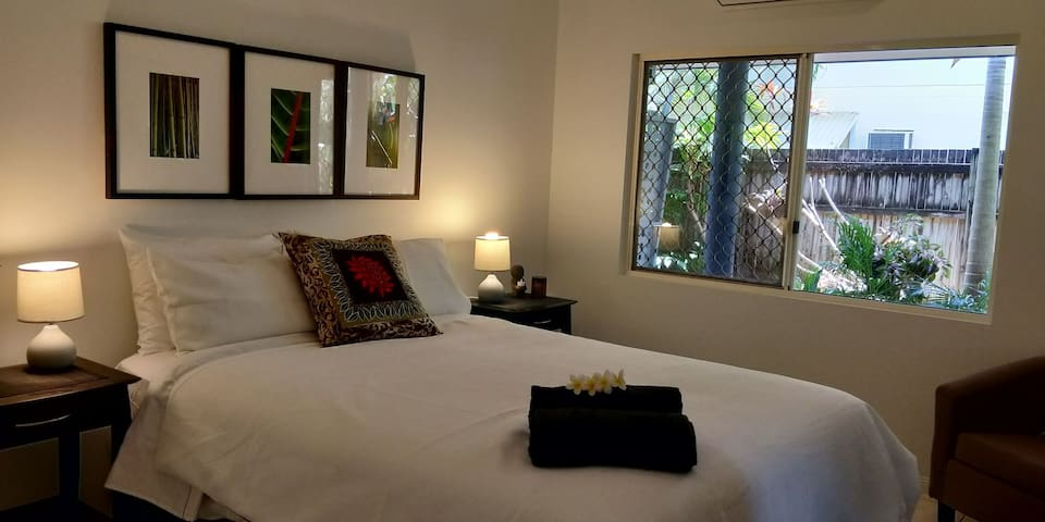 Master bedroom with quality queen bed,  good linen, bath towels and privacy.