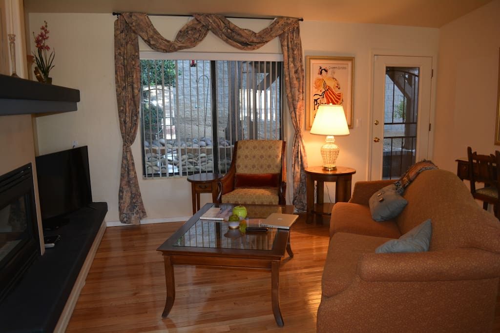 The living room is comfortable and spacious. We offer DISH TV with HBO and sports channels... also wi-fi