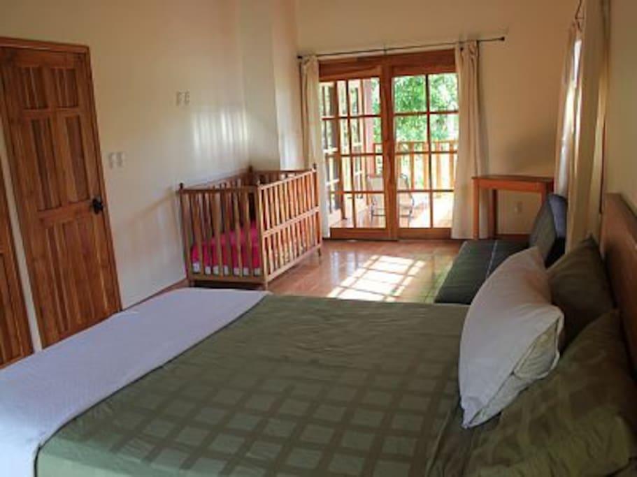 Master bedroom, queen bed, crib, futon, ensuite bathroom