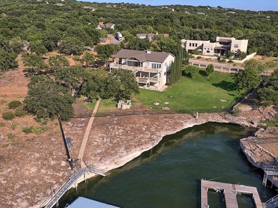 Aerial view to back of two acre property and private cove attached to property.