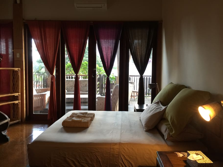 Back bedroom with super comfortable King size hardwood bed and air-conditioner