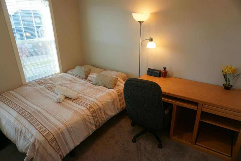 Your private room with a queen size bed.