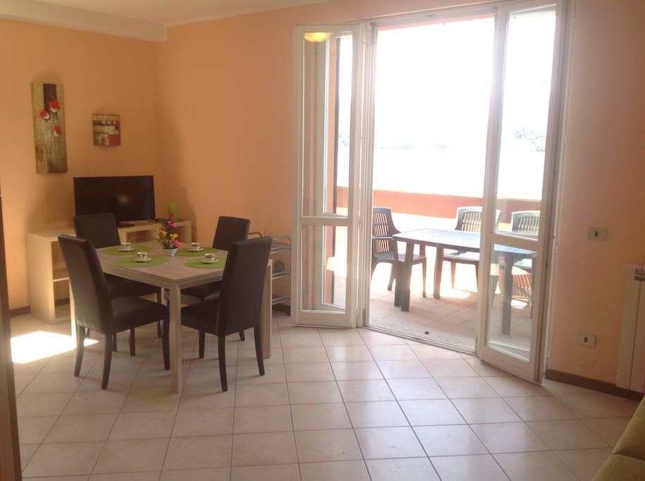living with terrace, table, chairs, deck chairs, TV, Wi fi fast
