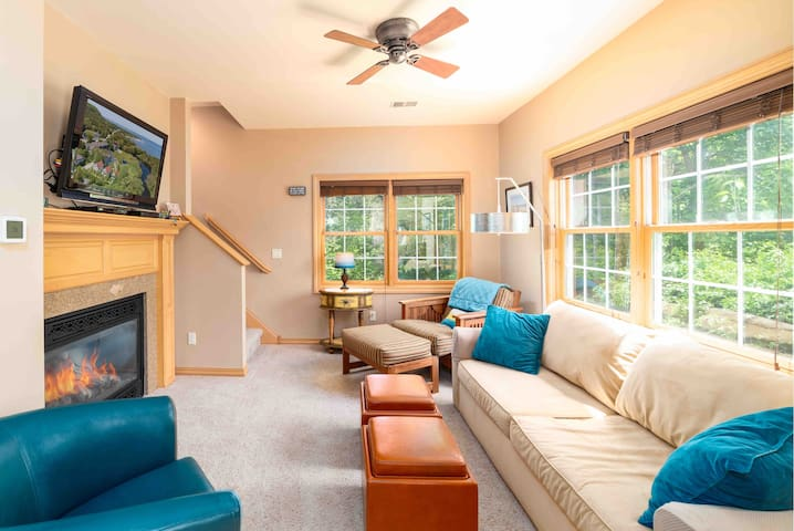 Relax in our bright and cheery living room.  Draw the blinds and turn the fireplace on for a warm, cozy evening.